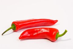 Red paprika Peppers. Studio work, white table Stock Images