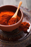 Red paprika powder spice in bowl Stock Photography