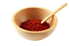 Red paprika powder in wooden bowl and spoon Royalty Free Stock Images