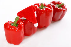 Red paprika with Santa's red hat Royalty Free Stock Image