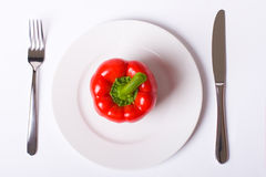 Red paprika on white plate Stock Photography