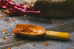 Red paprika on a wooden table. Shot in a few different positions Royalty Free Stock Images
