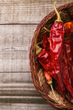Red paprika on a wooden table. Shot in a few different positions Stock Images