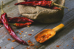 Red paprika on a wooden table. Shot in a few different positions Stock Photo