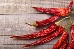 Red paprika on a wooden table. Shot in a few different positions Royalty Free Stock Photography