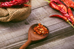 Red paprika on a wooden table. Shot in a few different positions Royalty Free Stock Photos