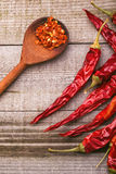 Red paprika on a wooden table. Shot in a few different positions Royalty Free Stock Image