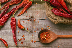 Red paprika on a wooden table. Shot in a few different positions Stock Photography