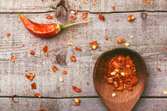 Red paprika on a wooden table. Shot in a few different positions Stock Photos