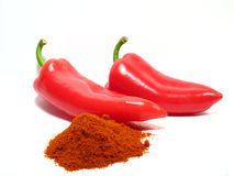 Red paprikas and ground paprika Stock Photos