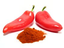 Red paprikas and ground paprika Royalty Free Stock Photo
