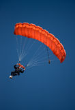 Red parachute against blue sky royalty free stock images
