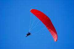 Red parachute banking. In approach for landing Royalty Free Stock Images