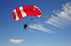 Red parachute. Landing on windy sky Royalty Free Stock Photo