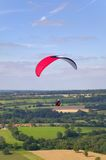 Red paraglider Stock Images