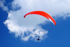 Red paraglider. In blue beautiful sky Royalty Free Stock Image