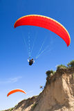 Red paraglider on the blue sky Stock Image