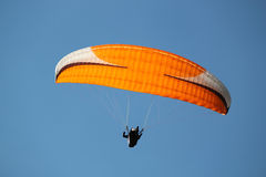 Red paraglider in deep blue sky Royalty Free Stock Photo