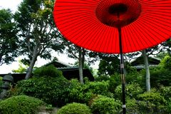 Red Parasol in Japanese Garden Stock Photos