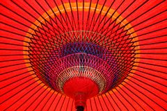 Red Parasol Underneath. Looking up at a colorful red parasol in Japan Royalty Free Stock Photography