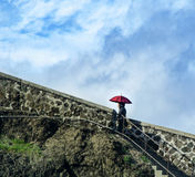 Red Parasol Woman. Istanbul, Turkey. Rumeli fishing villages, stairs the women from the fishing boat shelter It creates a beautiful image Royalty Free Stock Photos