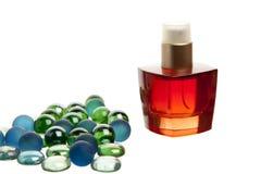 Red parfume bottle on white background Stock Photo