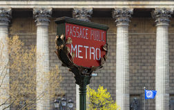The Red Paris metro sign and Madeleine church in the background. Stock Photography