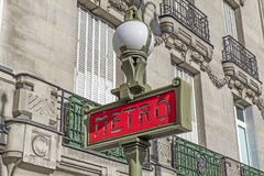 Red Paris Metro subway sign with street lamp Royalty Free Stock Images