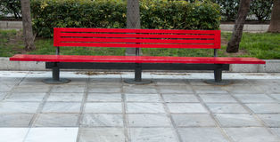 Red park bench. Bright red park bench in the city of Almeria Royalty Free Stock Photos