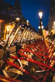 Red parked rental bikes at night perspective shot. From Barcelona royalty free stock images