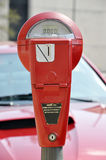 Red Parking Meter. On downtown street Stock Image