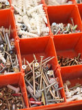 Red partitioned Box of Electricians screws Royalty Free Stock Photo