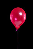 Red party balloon on black Royalty Free Stock Photo
