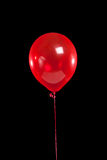 Red party balloon on black Royalty Free Stock Photography