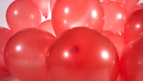 Red party balloons stock video footage