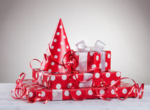 Red party hat and gift box.  royalty free stock photography
