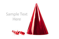 A red party hat and streamer on white Royalty Free Stock Image