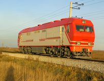 Red passenger locomotive at evening Stock Image