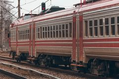Red passenger train. Red diesel passenger train driving at the old terminal royalty free stock photography