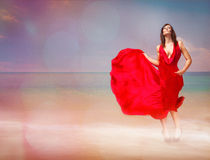 Red passion on the beach Royalty Free Stock Photos
