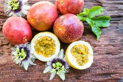 Red passion fruit. On an old wood background royalty free stock photo