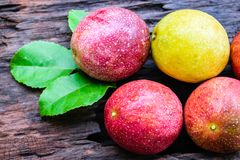 Red passion fruit. On an old wood background royalty free stock image