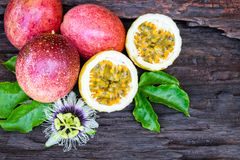 Red passion fruit. On an old wood background stock image