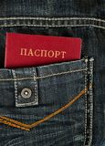 Red passort and jeans Royalty Free Stock Image