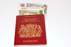 Red passport and british pounds Royalty Free Stock Images