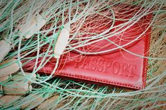 Red passport closeup caught in a fishing net. The concept of the fight against poachers and illegal sturgeon fishing. Top view stock photo