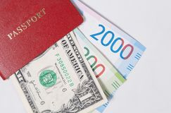 Red passport with the dollar and the new Russian banknotes rubles or euros Stock Photos