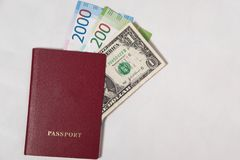 Red passport with the dollar and the new Russian banknotes rubles or euros Stock Photo