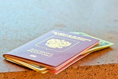Red passport with dollars on marble surface Royalty Free Stock Image