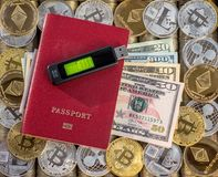 Red passport, metal coins background. US dollars Paper bills. Metal coins. Gold silver bitcoin, crypto currency, identification. M. Emory card USB storage flash royalty free stock photo